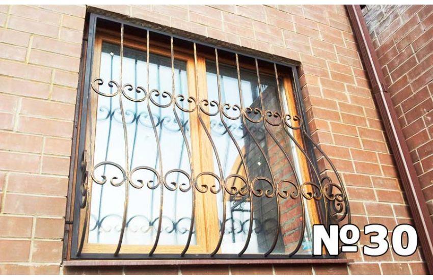 кованая решетка на арочное окно